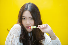 Woman biting gelatin candy Stock Photos