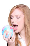 Woman biting globe Royalty Free Stock Photo