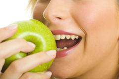 Woman biting green apple Royalty Free Stock Photography