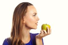 Woman biting green apple Royalty Free Stock Image