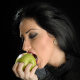 Woman Biting Green Apple Royalty Free Stock Photos