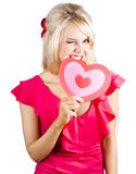 Woman biting heart Royalty Free Stock Photos