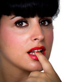 Woman biting her finger Stock Photography