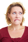 Woman biting on her lip. An embarrassed woman biting on her lip Royalty Free Stock Photography