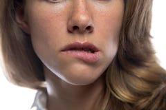 Woman biting her lip Royalty Free Stock Photos