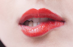Red lips biting Royalty Free Stock Images