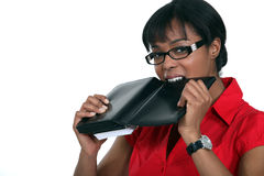 Woman biting her organizer Stock Photos