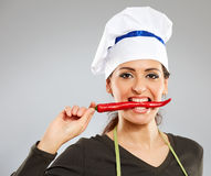 Woman biting hot chili pepper Royalty Free Stock Image