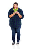 woman biting lettuce Stock Photo
