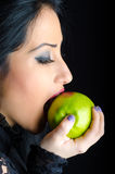 Woman Biting a Lipstick Smeared Green Apple Stock Photo
