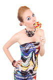 Woman biting lollipop Royalty Free Stock Images