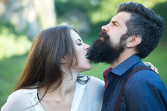 Woman biting male beard Royalty Free Stock Photo