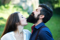 Woman biting male beard Royalty Free Stock Photos