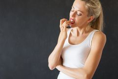 Woman biting nails. Healthcare problem stock photography