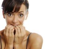 Woman biting nails Royalty Free Stock Photos