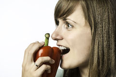 Woman biting in pepper Royalty Free Stock Photo