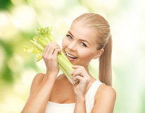 Woman biting piece of celery or green salad Royalty Free Stock Photo