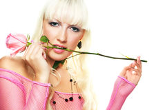 Woman biting a pink rose Royalty Free Stock Photography