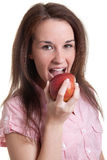 Woman biting into a red apple Stock Photography
