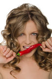 Woman biting red pepper Royalty Free Stock Photos