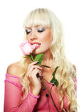 Woman biting a rose Royalty Free Stock Photography