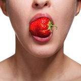 Woman biting strawberry on white Royalty Free Stock Image