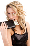 Woman biting a wallet Royalty Free Stock Image