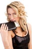 Woman biting a wallet Royalty Free Stock Image