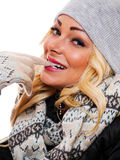 Woman bitting her gloved finger. A woman is bitting her gloved finger while dressed for winter looking into the camera stock photos