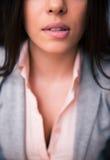 Woman bitting her lips Stock Photo
