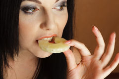 Woman bitting pineapple Royalty Free Stock Photo