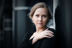 Sad beautiful woman in black dress Royalty Free Stock Photos