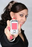 Woman in black. The attractive girl shows phone Royalty Free Stock Images