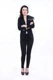 Woman in black. Woman dressed in black on black high heels Royalty Free Stock Images