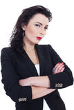 Woman in black. Woman dressed in black posing to a camera Royalty Free Stock Images