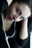 Woman in black. With pearls Stock Photos