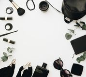 Woman black accessories grouped around empty space for text. royalty free stock photography
