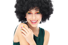 Woman with black afro hairstyle. Woman wearing wig over white background Royalty Free Stock Images