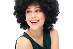 Woman with black afro hairstyle. Woman wearing wig over white background Royalty Free Stock Photography