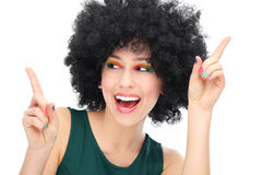 Woman with black afro wig laughing. Woman wearing wig over white background Stock Photo