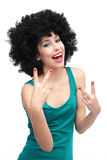 Woman with black afro wig laughing. Woman wearing wig over white background Royalty Free Stock Photos