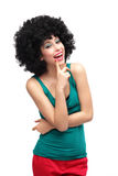 Woman with black afro wig laughing. Woman wearing wig over white background Royalty Free Stock Photography