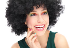 Woman with black afro wig laughing Royalty Free Stock Photos