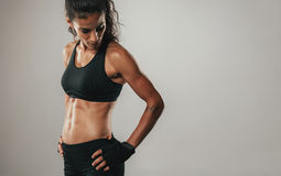 Woman in black athletic top looks over shoulder royalty free stock image