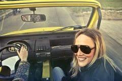 Woman In Black Aviator Sunglasses Sitting On Car's Passenger Seat Stock Image
