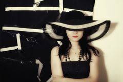 Woman on black background in summer hat Royalty Free Stock Image