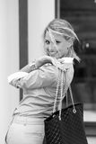 Woman with black bag. Royalty Free Stock Photography