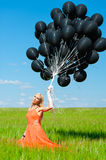 Woman with black balloons Royalty Free Stock Photo