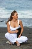 Woman on the Black Beach Stock Image