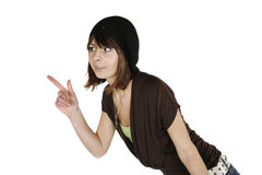 Woman in black beret. Beautiful emotional young woman in black beret pointing towards open space royalty free stock image